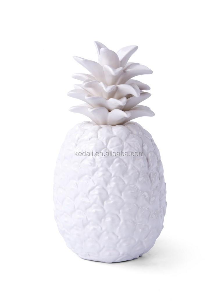 white ceramic pineapple decor