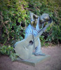 bronze little boy statue with glasses playing guitar