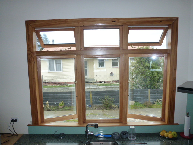 Wood frame window solid glass window wooden window design for Window glass design in kerala