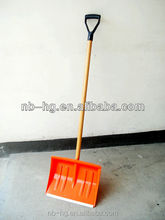 Plastic snow shovel with long wooden handle