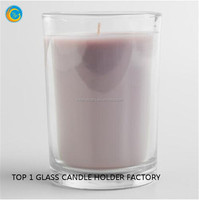 scented candle in clear glass container