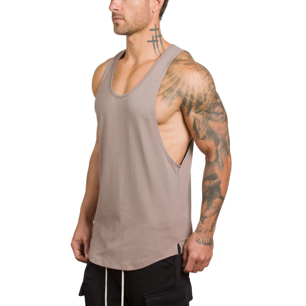 cb0461dadc230 OEM custom mens tank top gym loose fit muscle cut stringer tank tops  wholesale