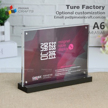 for table top showcasing name office supply store marketing holders