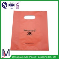 2.5 Mil orange LDPE film customer bags die cut handle bags