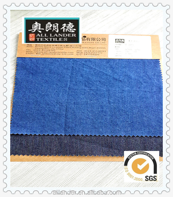 "deep blue color 30 % C and 7 % R 4.8 oz 57 / 58 "" twill low price denim fabric"