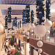 Big polyfoam glittering ball and lighted christmas garland as shopping mall hanging decorations