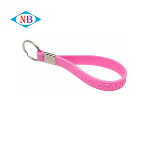 Bulk cheap silicone wristband key ring logo embossed silicone custom keychain