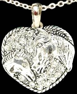 FTH Clear Crystal Rhinestone Heart with Two Horses Engraved. Pendant is Embellished with Clear Crystal Rhinestones & arrives Gift Boxed on an 18 inch Chain.Perfect Gift for the Cowgirl in your Life!