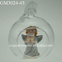 hanging Christmas opening glass ball ornament with an angel inside