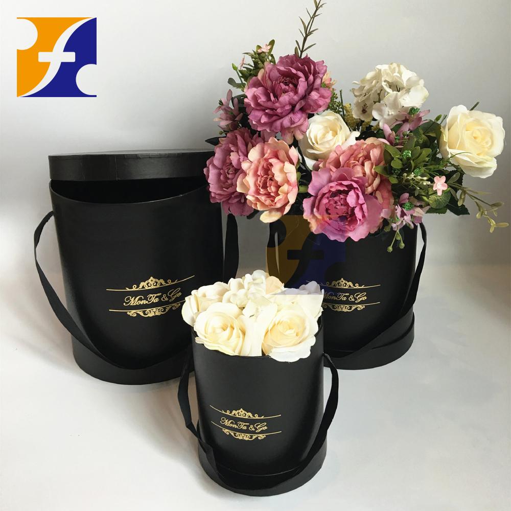 belle fleur cadeau bo te ronde cylindre emballage de fleurs fra ches bo te avec poign e caisses. Black Bedroom Furniture Sets. Home Design Ideas