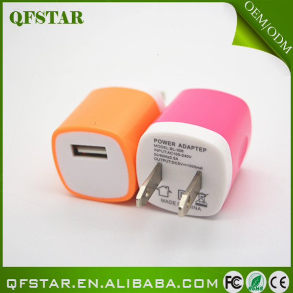 Portable fashional travel adaptor for mobile phone