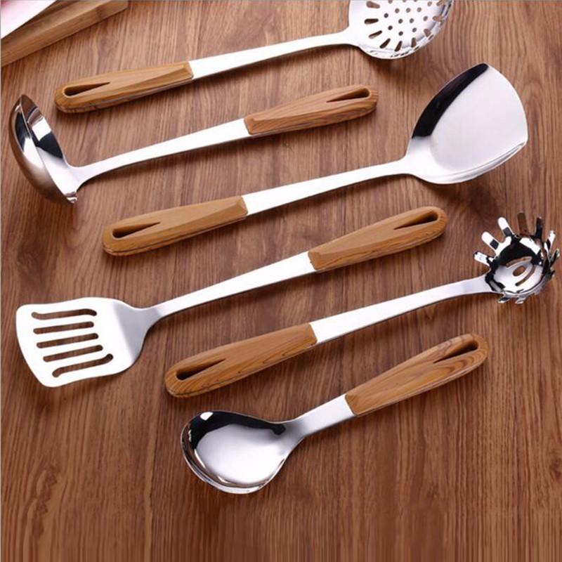 Anti-caliente mango de madera utensilios de cocina de acero ...