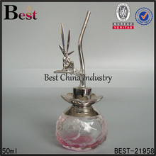 decorative ornamental 50ml small sized pink round aluminum sprayer special designed artistic cap glass perfume bottle