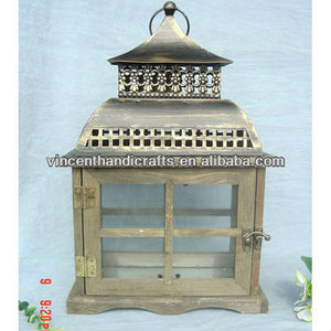 Hanging vintage country wooden candle lantern with antique brass metal top