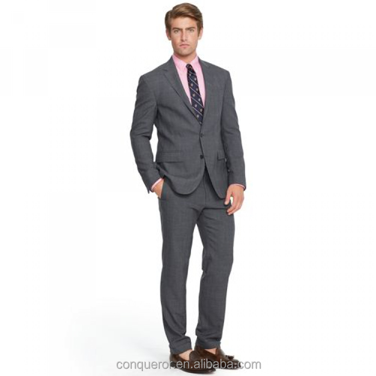 Men suit. The two-button jacket is designed with carefully rolled lapels; lightly padded, made to measure suit. (SUIT14081502)