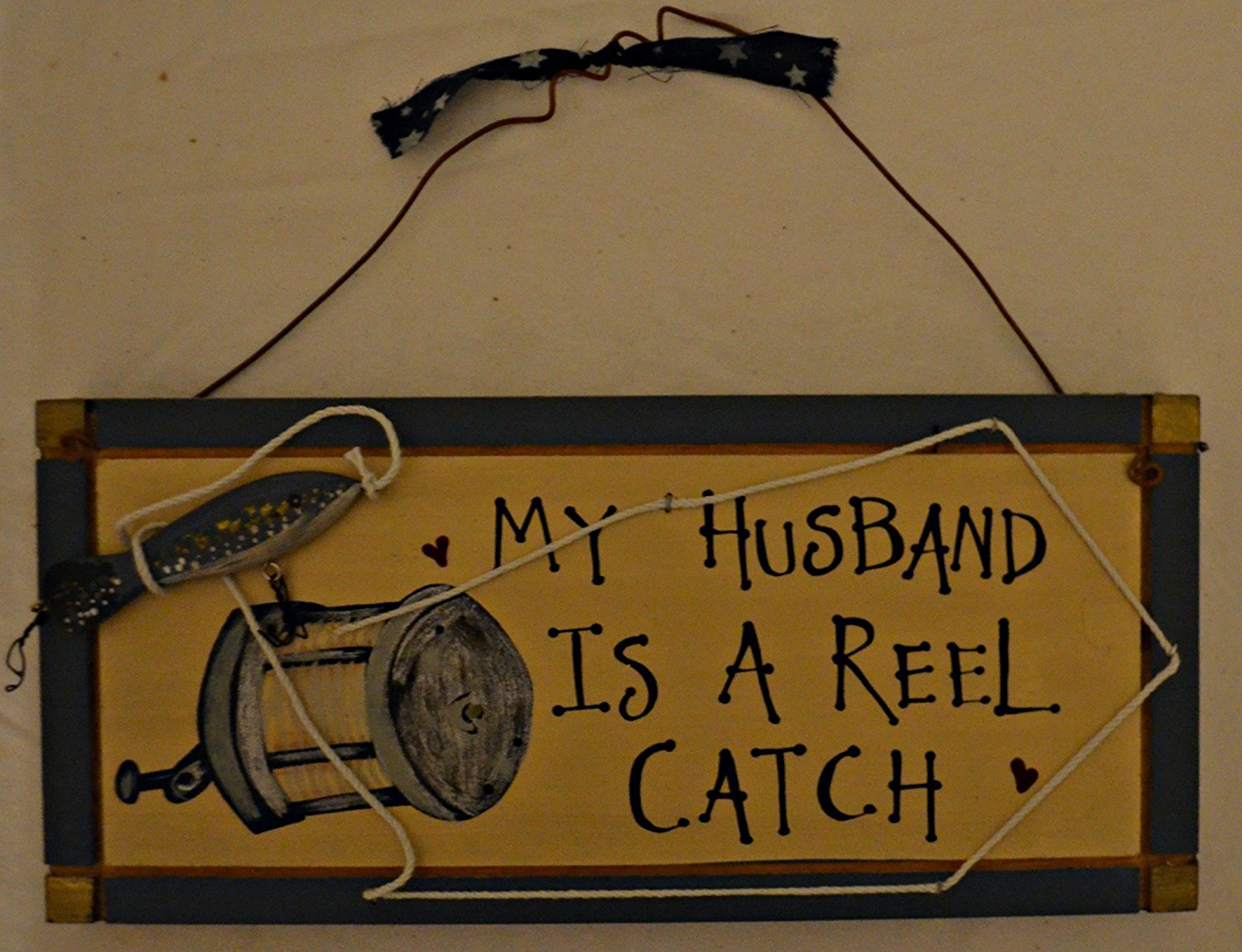 "Rustic Country Wood Plaque Sign Decoration with a Metal Wire for Hanging 12 x 5 1/2 x 1 Inches. Wooden Sign Saying ""My Husband Is A Reel Catch"" with Decoration Fishing Line, Lure, Hook and Blue Border"