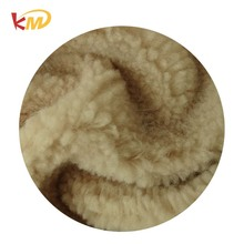 Polyester mongolian rolling raw cashmere wool fabric textile material with cheap price