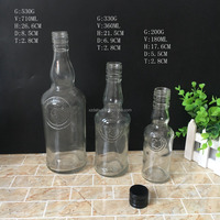 FDA factory price 180ml 350ml 700ml customized empty glass liquor bottle with cap