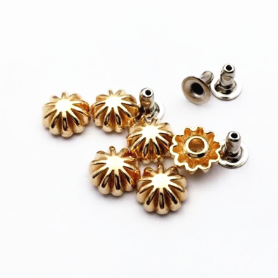 gold/ copper flower shape rivets