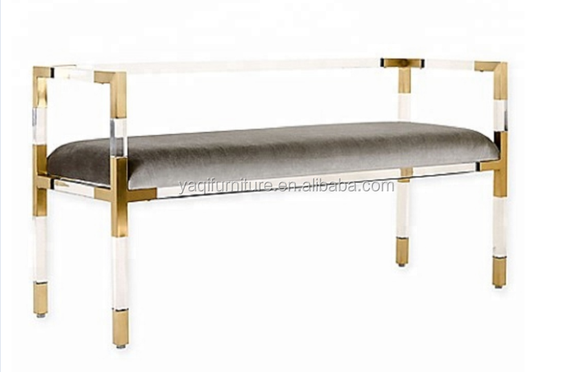 A long clear acrylic Bed Brass corner Bench with a cushion in living room