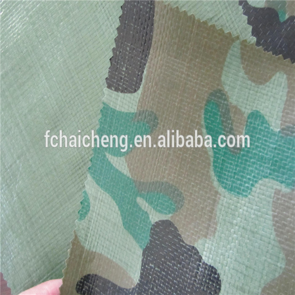 Camouflage poly tarp which is easy to use and install used for covering forest and woodland