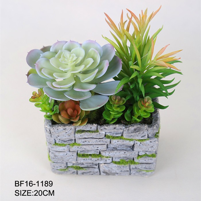 Artificial green succulent plant with cement pot