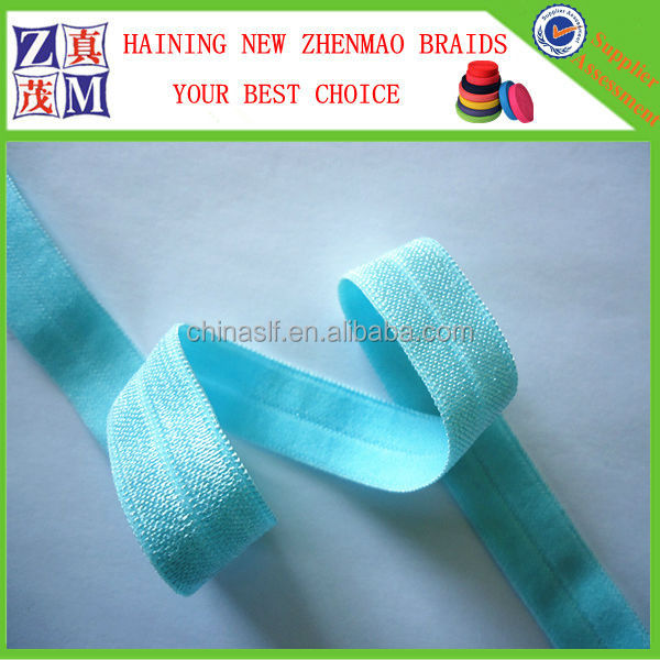 Decorative shiny fold over elastic tape