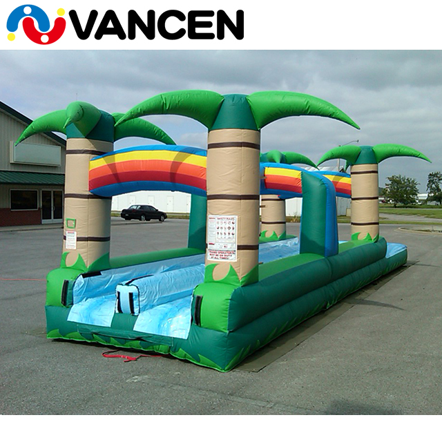 popular spring customized size CE approved durable double lane green tropical infltable plams water slip slide for outdoor use