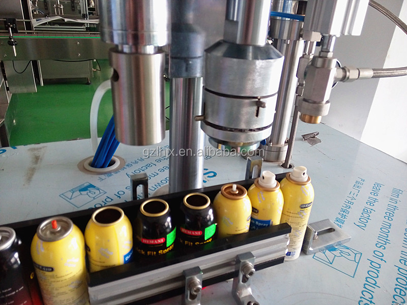 Aerosol spray filling machine, semi automatic aerosol can filling machine, machine to fill aerosol cans