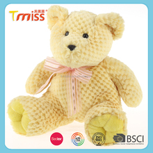 Pure yellow stuffed teddy bear with bow ties