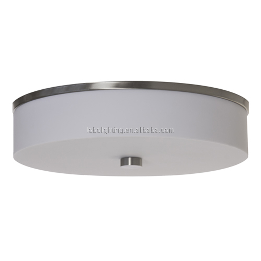 Wall sconce with brushed chrome finish and a white acrylic lens shade