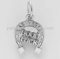 silver good luck horseshoe charm with LAS VEGAS carved on the top pendant