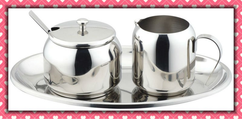stainless steel milk jug and sugar set on tray
