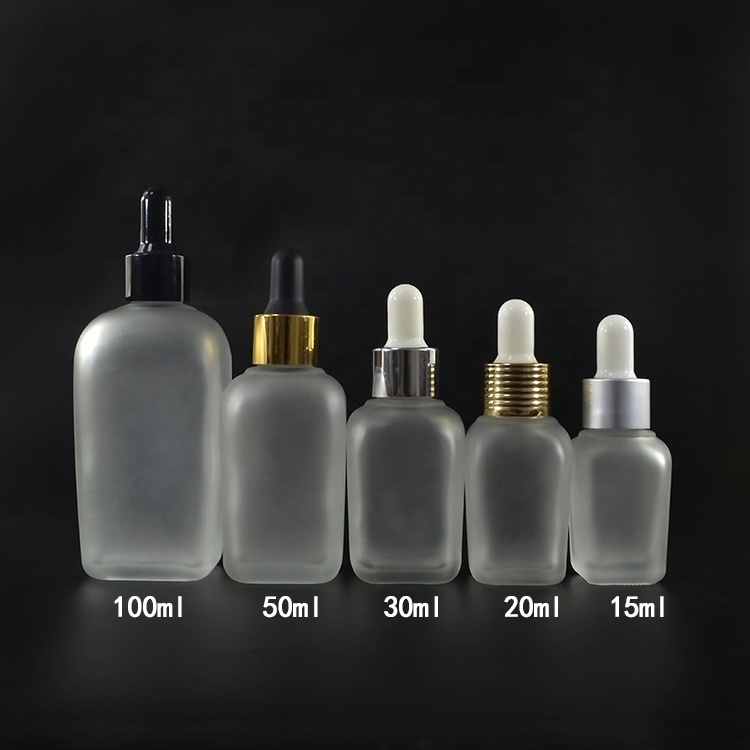 Fancy square 15ml 20ml 30ml 50ml 100ml 30 ml clear frosted clear perfume glass dropper bottle with gold hollow caps
