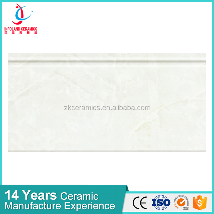 Light-colored kitchen ceramic tile with patterned decorative