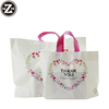 /product-detail/custom-printed-logo-design-tote-punching-carry-handle-fashion-gift-plastic-bag-for-shopping-clothing-60750520182.html