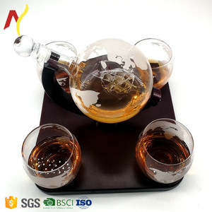Globe whiskey decanter with 4 glasses and wooden tray