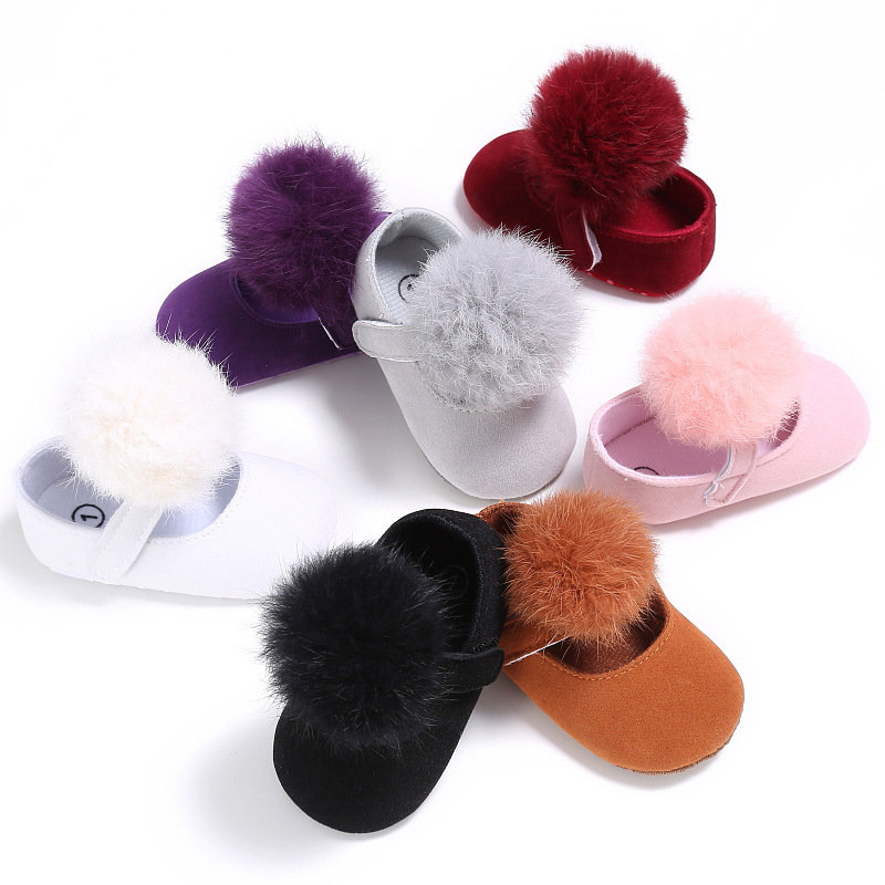Stylish bowknot soft sole low price cute pompon baby girl shoes