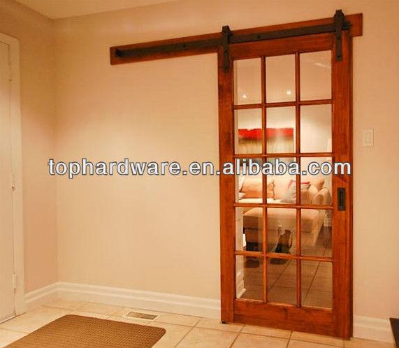 Puertas correderas de estilo granero modern interior for Como hacer rieles para puertas corredera