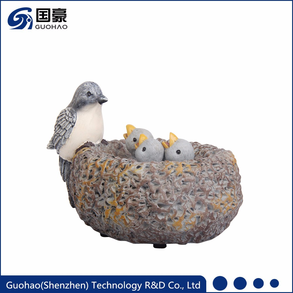 Mother bird feeding worms to cute baby resin statue