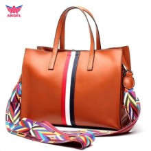 Guangzhou factory latest fashion big capacity bag genuine leather ladies handbag with colorful wide strap belt