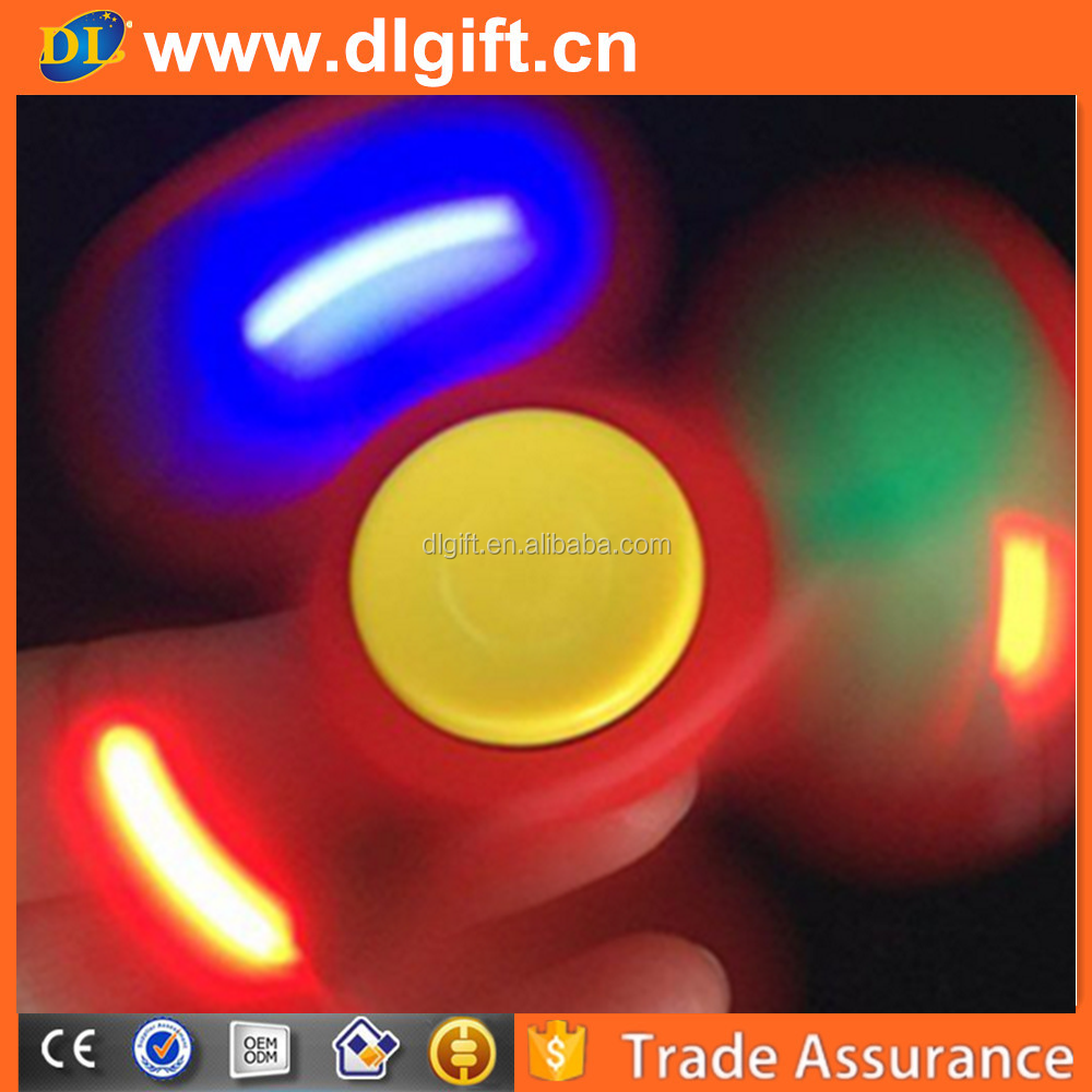 England best selling cheap plastic led light spinner toy for adult