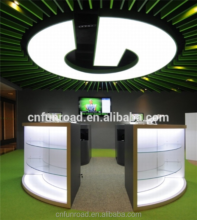 modern cell phone display table mobile phone accessory retail store interior design with green spotlights
