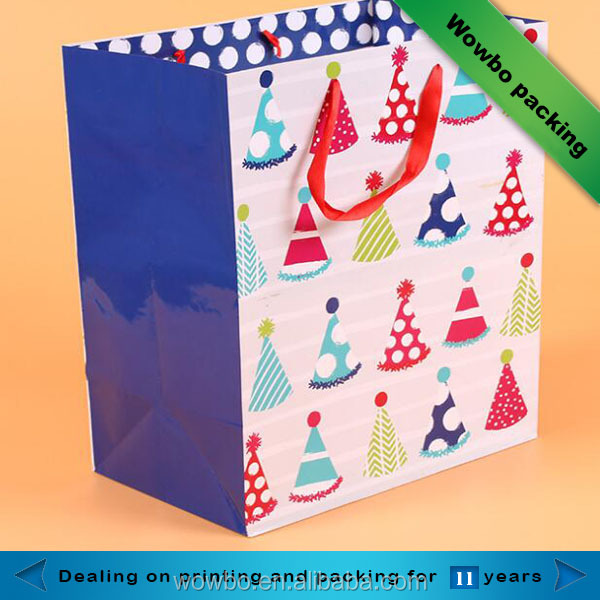 Promotional glossy lamination christmas gift paper bag with ribbon handle