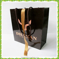 Custom Logo Printed gloss lamitation shopping paper bag with ribbon handle for cloth Wholesale