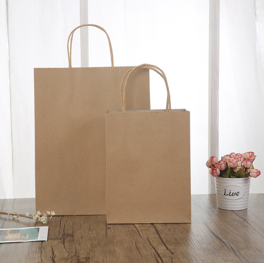 China gift bag manufactures biodegradable kraft materials twisted handle brown paper bag