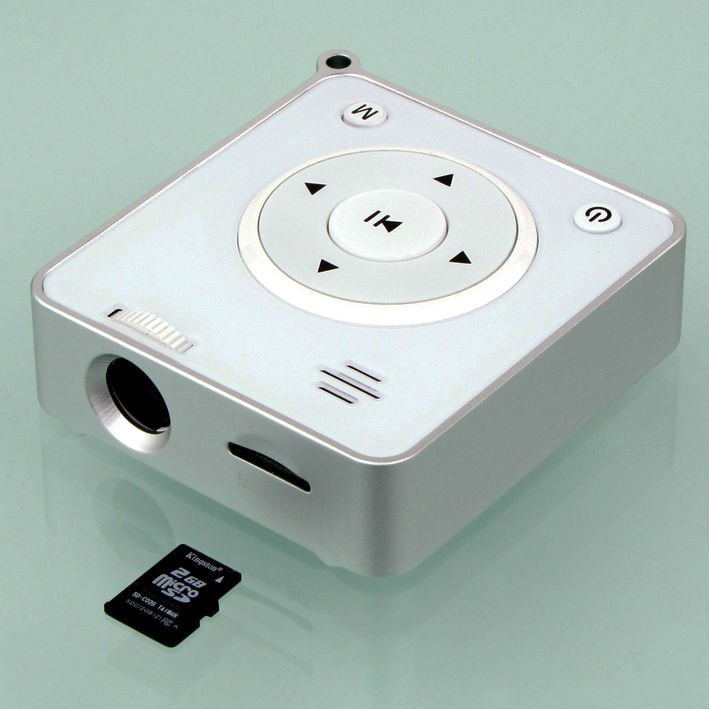 2012 Fashion 8lumens computer-connecting mini projector with MP3 and movie play