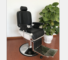 Black barber chair with stainless footrest;Reclining hairdressing chair for beauty salon;Hot sale salon furniture