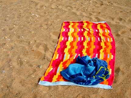 beach towel on beach. Plain Towel Throughout Beach Towel On