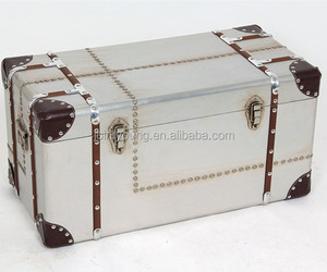 Antique metal trunk box covered with vintage aluminum